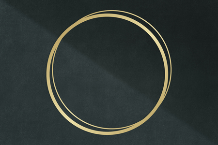 Gold circle frame on a dark gray concrete textured background Stock Photo