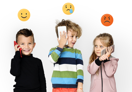 Children with emoticons talking on mobile phones 版權商用圖片