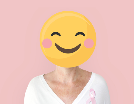 Woman with pink ribbon for breast cancer awareness portrait