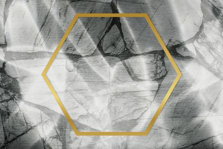 Golden framed hexagon on a marble texture 스톡 콘텐츠