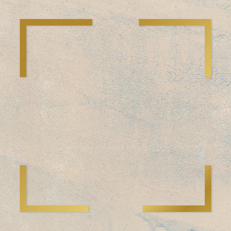 Gold square frame on a rough beige background