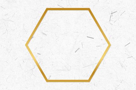 Golden framed hexagon on a paper texture