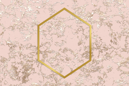 Gold hexagon frame on a rough rose gold background