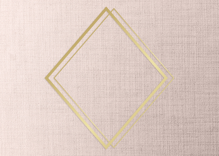 Gold rhombus frame on a peach fabric background Reklamní fotografie