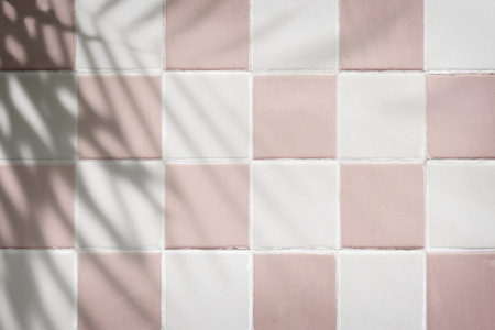 Pastel pink and white tiles textured background
