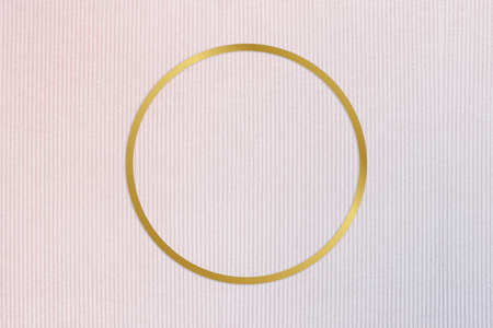 Gold round frame on a pinkish blue fabric background Stock Photo