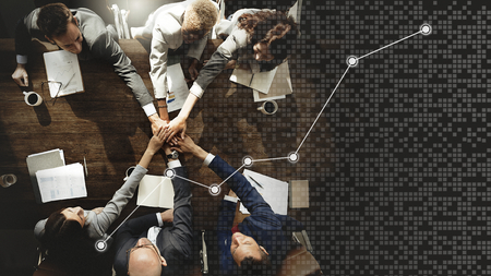 Business people stacking hands together Stockfoto - 119997926