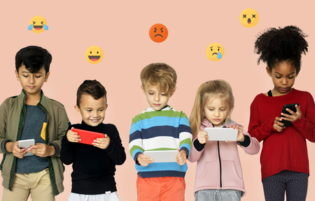 Group of kids playing on mobile phones