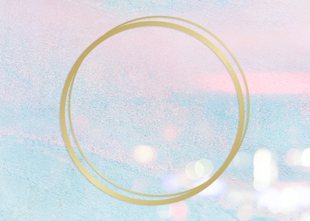 Gold round frame on a pastel pink and blue concrete textured background Banco de Imagens
