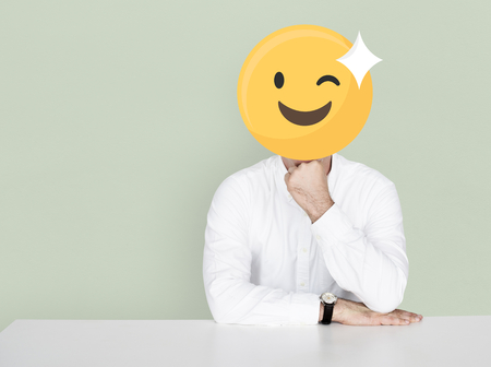 Winking face emoji portrait on a man