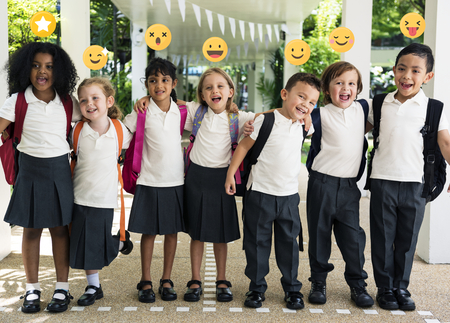 Cheerful elementary kids in school