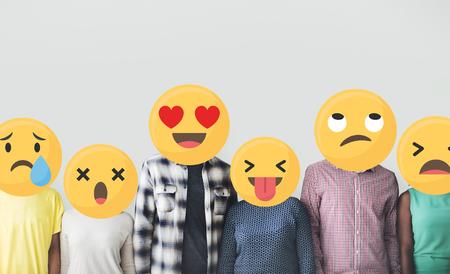 Diversos amigos cubiertos de emoticonos Foto de archivo