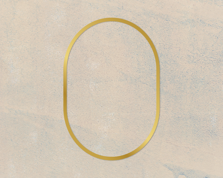 Gold oval frame on a rough beige background Stockfoto
