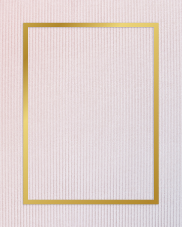 Gold rectangle frame on a pinkish blue fabric background Stock Photo