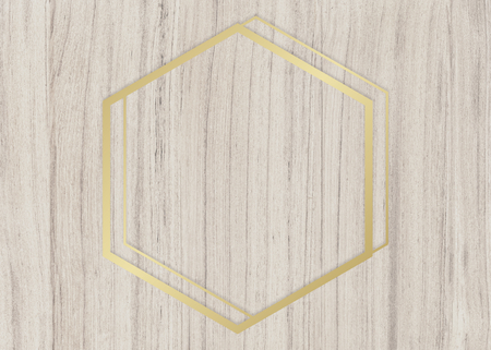 Gold hexagon frame on a wooden background Imagens