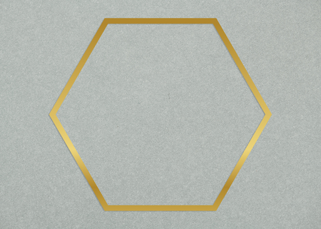 Gold hexagon frame on a gray concrete textured background
