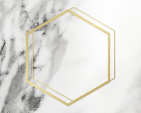 Golden framed hexagon on a marble texture 写真素材