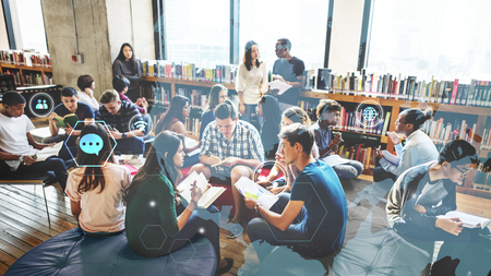 Group of diverse students working in a school library Stockfoto