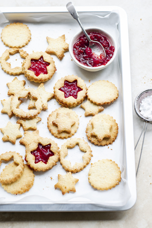 Star shaped cookies filled with cranberry sauce Stock fotó