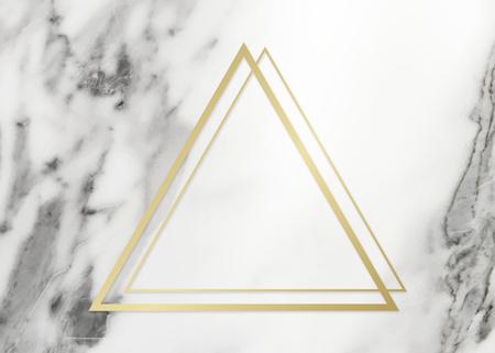 Golden framed triangle on a marble texture Zdjęcie Seryjne