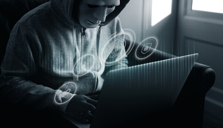 Hacker hacking a computer security system Stock Photo