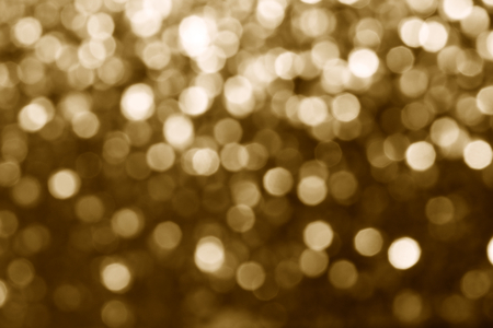 Blurry shiny gold glitter textured background
