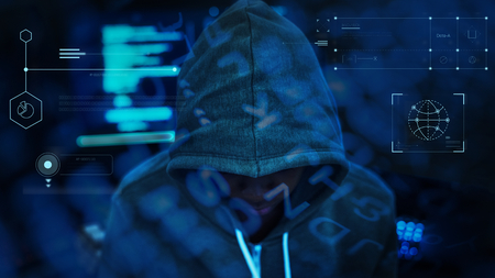 Hacker working in the darkness Stock Photo