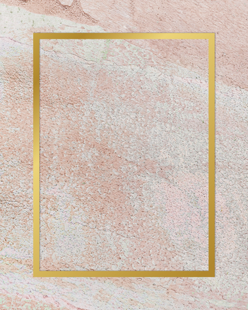 Gold rectangle frame on a rustic pastel pink background