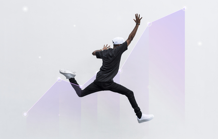 Black man jumping in to the air