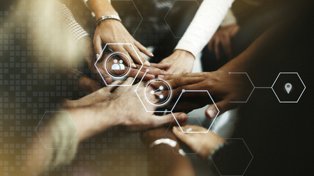 Business people stacking hands together