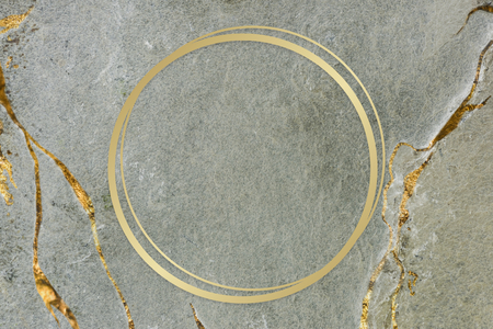 Golden framed circle on a marble texture