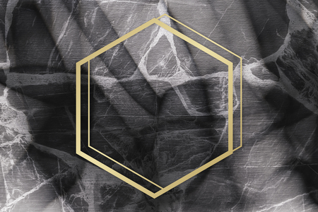 Golden framed hexagon on a marble texture 写真素材