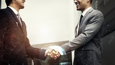 Two corporate businessmen shaking hands