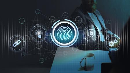 Businessman observing the fingerprint scanning system
