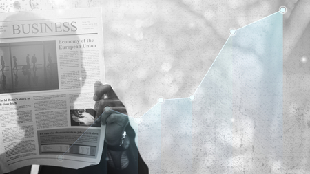 Man reading a business newspaper Imagens