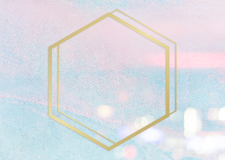 Gold hexagon frame on a pastel pink and blue concrete textured background illustration Stock Photo