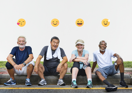 Group of senior friends relaxing together after an exercise