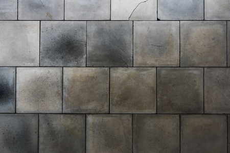 Grunge gray and white tiles textured background