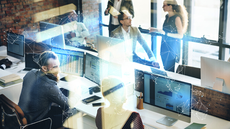 Business colleagues talking with each other at the office Banque d'images - 120560340