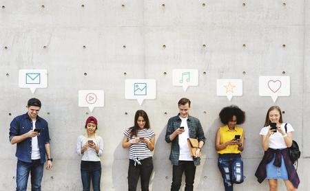 Group of diverse people using their phones Reklamní fotografie