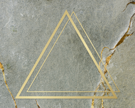 Golden framed triangle on a marble texture Stock Photo