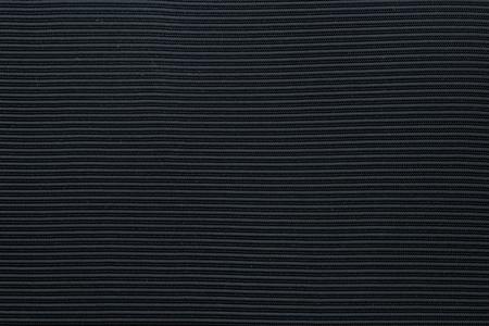 Navy blue corrugated fabric textured background Фото со стока
