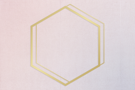 Gold hexagon frame on a pinkish blue fabric background