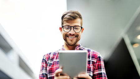 Cheerful man using a tablet