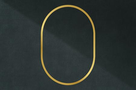 Gold oval frame on a dark gray concrete textured background illustration Standard-Bild - 120341999