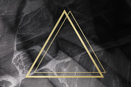 Golden framed triangle on a marble texture 스톡 콘텐츠
