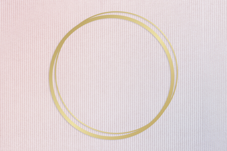 Gold round frame on a pinkish blue fabric background Reklamní fotografie