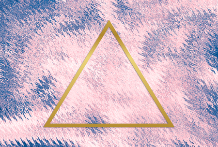 Gold triangle frame on a pink abstract background Reklamní fotografie