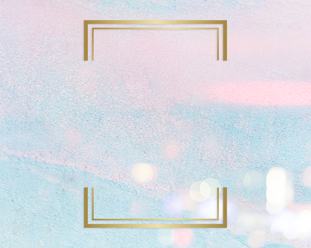 Gold rectangle frame on a pastel pink and blue concrete textured background Reklamní fotografie