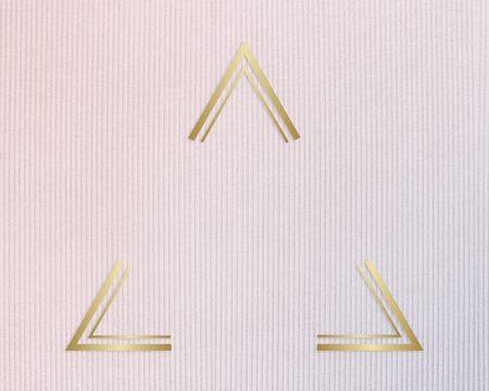 Gold ftriangle rame on a pinkish blue fabric background Stock Photo